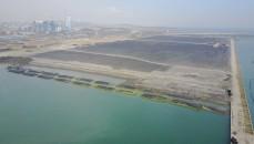 Sử dụng ống vải địa kỹ thuật khổng lồ để tạo kè chắn tạm thời cho việc bồi đắp đất tại cảng